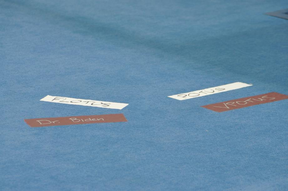 Stage markings on carpet in front of the podium, for participants in the ceremony to come