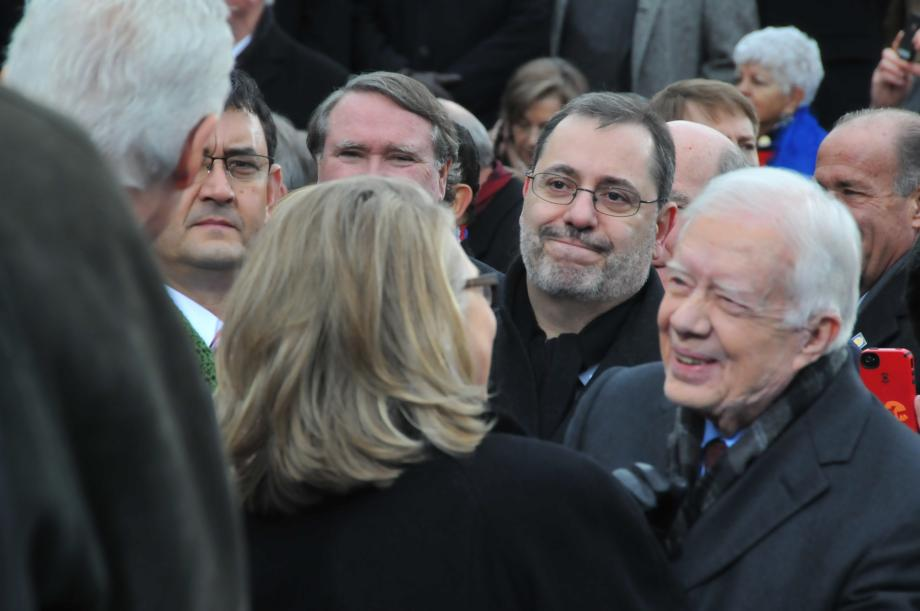 Here, Secretary of State Hillary Clinton speaks with President Carter.