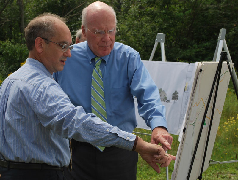 Senator Leahy examines plans for new workforce housing to be located at the former Ethan Allen plant in Randolph.  He is pictured above with Chuck Lief, the project developer.