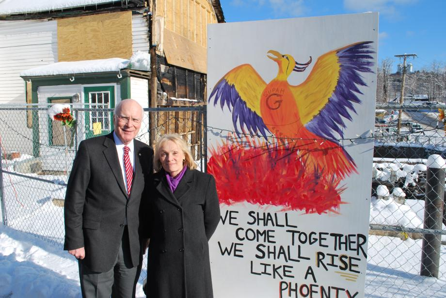 Senator Leahy met with representatives of the Putney Historical Society at the site of the twice burned Putney General Store. During his visit, Senator Leahy announced a new $60,000 federal grant that will ensure construction on the new General Store can begin this year. Senator Leahy is shown here with his wife Marcelle in front of the site.