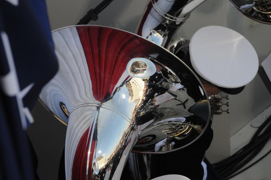 The day is reflected in a tuba.