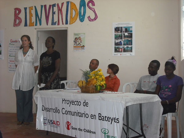 Peace Corps representatives in the Batey Community in the Dominican Republic speak to members of the Congressional Delegation.