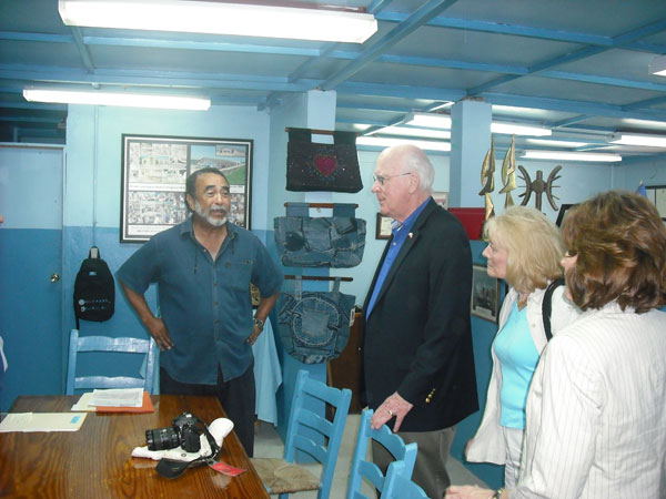 Senator Leahy, Marcelle Leahy and members of the Congressional Delegation meet with Hans Garoute, CEO of INDEPCO manufacturing in Haiti.