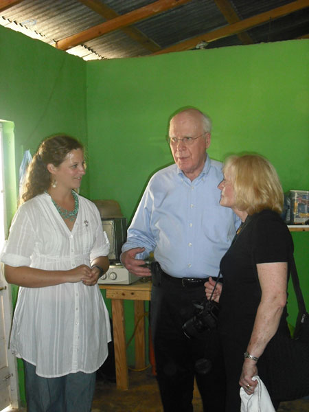 Senator Patrick Leahy and Marcelle Leahy speak with Peace Corps volunteer Kerri Magee in her home in the Dominican Republic.