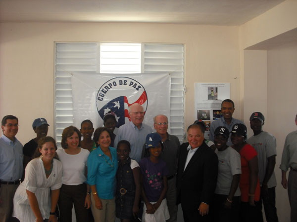 Members of the Congressional Delgation pose with children of the Batey Community in the Dominican Republic and Peace Corps volunteers stationed there.