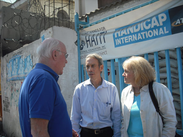 Senator Leahy and Marcelle Leahy speak with an advisor outside of the Handicap International facility in Haiti