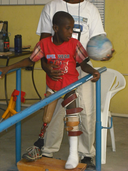 A child does exercises at the Handicap International facility in Haiti.  Provision of prosthetic limbs is one service provided by the organization.
