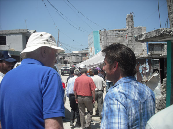 Sean Penn gives Senator Leahy a walking tour of the Internally Displaced Persons camp his relief organization helps to operate in Haiti.