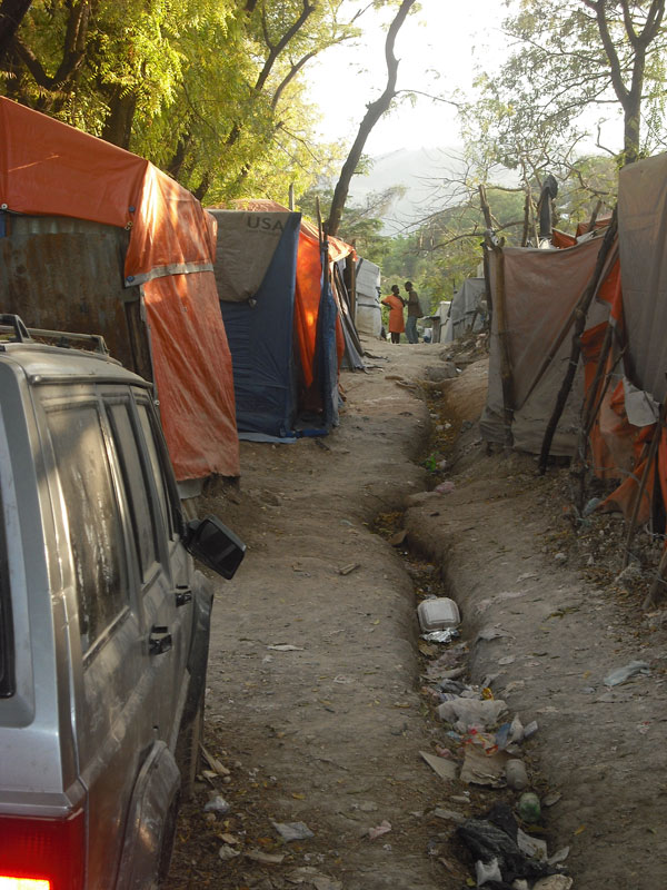Temporary shelters within an Internally Displaced Persons camp visited by members of the Congressioanl Delegation.