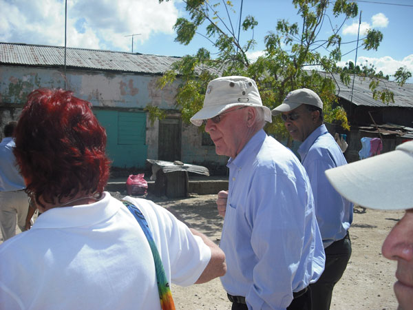 Senator Leahy, accompanied by Peace Corps Director Aaron Williams, walks through the Batey Community in the Dominican Republic.