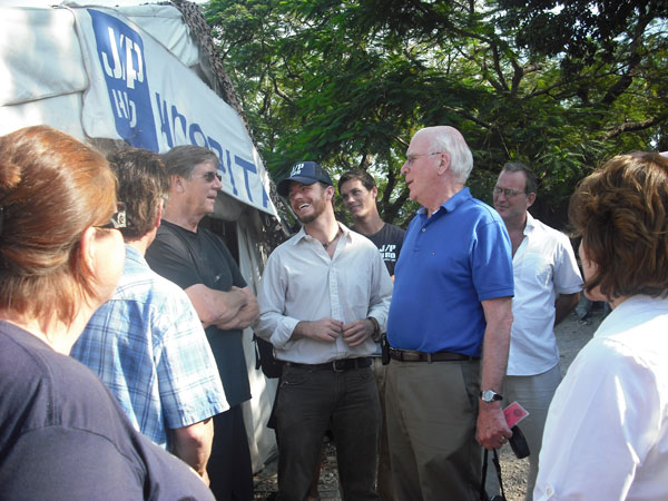 Senator Leahy speaks with representatives of J/P HRO, a relief organization working to support victims of the 2010 earthquake in Haiti.