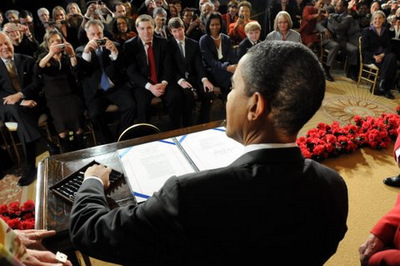From his vantage point behind the President, Senator Leahy was able to capture President Obama signing his first bill into law.